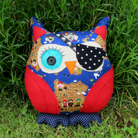A swashbuckling pirate owl cushion.  Nautical decor.