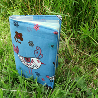 Chickens..  A fabric passport sleeve with a whimsical chickens