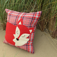 Red fox.  A snoozy fox cushion on tartan wool..  Complete with feather pad.