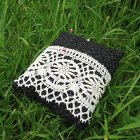 A pin cushion made from tactile wool and vintage lace.