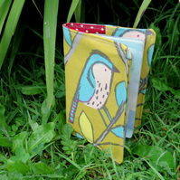 Blue bird.  A passport sleeve with a whimsical bird design.  Passport cover.