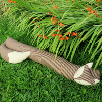 Long fox.  A draught excluder made from tactile Ilkley wool.