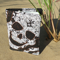 Skulls. A passport sleeve with a skulls design.  Passport cover.
