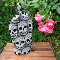 Skulls.  A cafetiere cosy, size small.  To fit a 2 cup cafetiere.  Coffee cosy.