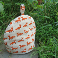 Foxes.  A medium sized tea cosy.  To fit a 3 - 4 cup teapot.