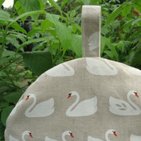 Swans.  A coffee cosy, size large.  To fit a 6 - 8 cup cosy.