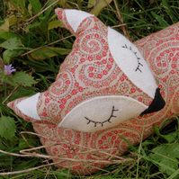 Long fox.  A draught excluder made from a paisley print cotton.