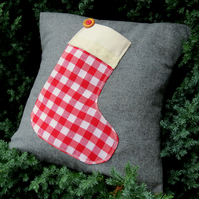 A festive Christmas cushion. The stocking opens to hold a small gift.