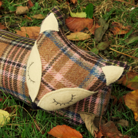 Long Fox. A draught excluder made from a tactile tartan wool.