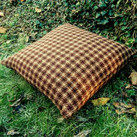 A large pet cushion.  Pet bed.  Complete with feather pad.  Made from pure wool.