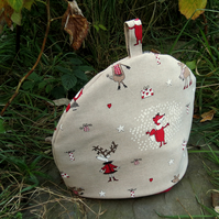 A festive tea cosy, size large.  30cm in width.  Christmas.