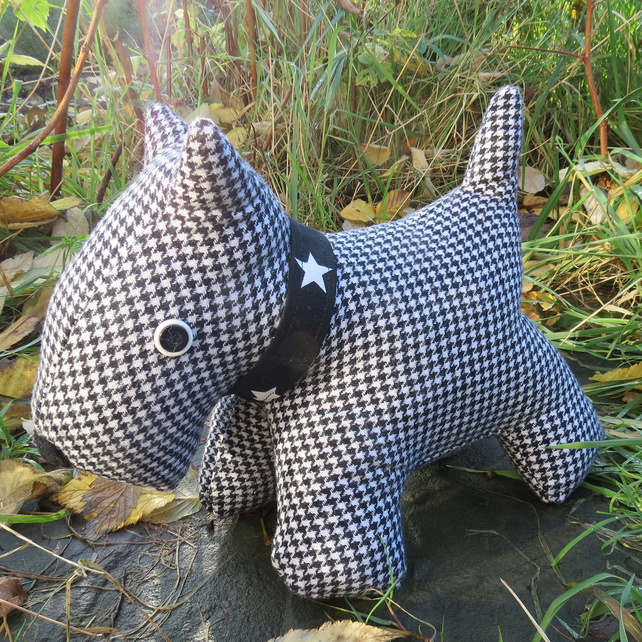 Scottie dog.  A scottie dog doorstop, made from a soft wool.