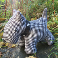 Dog Doorstop.  A scottie dog doorstop, made from a soft wool.