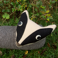 The curious badger.  A draught excluder made from wool.  98cm in length.