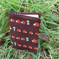 Hedgehogs.  A passport sleeve with a hedgehogs design.  Passport cover.