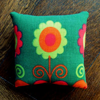 A pin cushion made from an iconic flower power fabric from the 1960s.