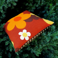 A pin cushion made from an iconic vintage fabric. 1960s flower power.
