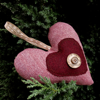 A hanging heart filled with fragrant lavender.  Heart door hanger.