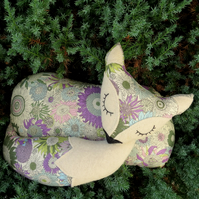 A snoozy fox cushion, made from Liberty Lawn.  35cm in length.