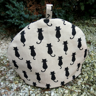 Black cat.  A tea cosy, size large.  To fit a  4 -  5  cup teapot.