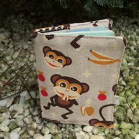 Monkey.  A passport cover with a monkeys design.  Passport sleeve.