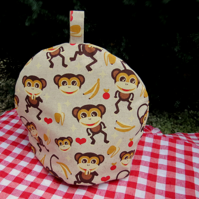 Monkeys.  A small tea cosy, made to fit a two cup teapot.