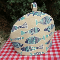 Blue fish.  A tea cosy, size medium.. To fit a 4 - 5 cup teapot.