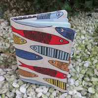 Fish.  A passport cover with a shoal of fish design.  Passport sleeve.