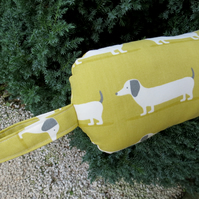 Long dog.  A draught excluder, 107cm in length.