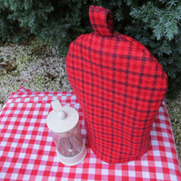 A small cafetiere cosy.  To fit a 2 cup cafetiere.  Red tweed cosy.
