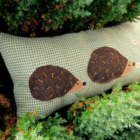 Hedgehogs.  A woollen cushion with tweed hedgehogs.  57cm x 30cm.