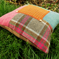 A large statement floor cushion.  Woollen cushion.  Complete with feather pad.