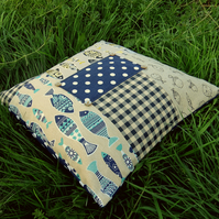 A patchwork floor cushion.  51cm x 51cm.  With feather pad.