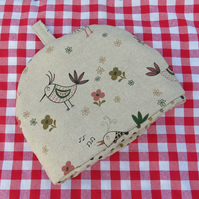 A tea cosy, size small.  To fit a 1- 2cup teapot.  Chickens design.