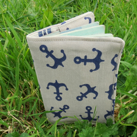 A passport cover with a nautical design.  Passport sleeve.