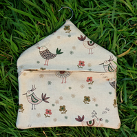 A peg bag with a quirky chickens design.  Peg storage.