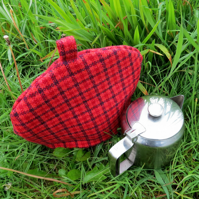 A tea cosy, size small.  Made to fit a 2 cup teapot.