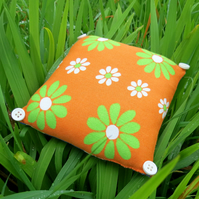 A lavender filled pin cushion.  Made from an iconic vintage flower power fabric.