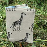 A passport cover with a giraffe design.  Passport sleeve.