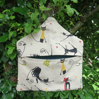 A peg bag with a quirky cats design.  Peg storage.