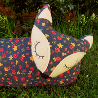 A fox draught excluder.  99cm in length.  (39 inches)   Floral fox.