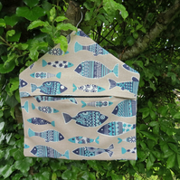 A peg bag with a Scandi fish design.  Peg storage.