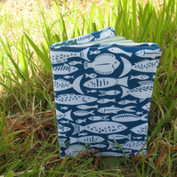 A passport cover with a fish design.  Passport sleeve.