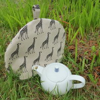 A tea cosy with a giraffe design.  Size large, to fit a 4 - 5 cup teapot.