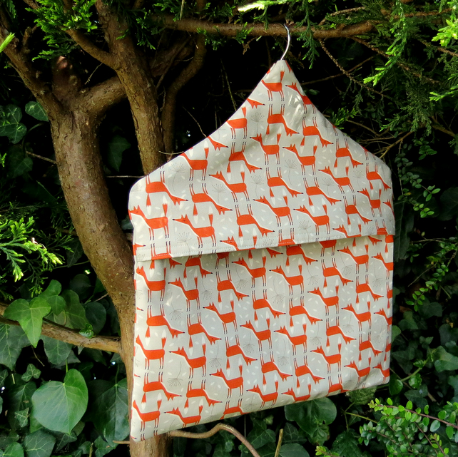 A peg bag with a foxes design.  Peg storage.