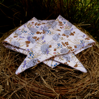 A dog bandana.  Size small to medium.  56cm x 19.5cm.