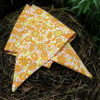 A dog bandana.  Size medium.  64cm x 23cm.  Groovy sixties flower power.