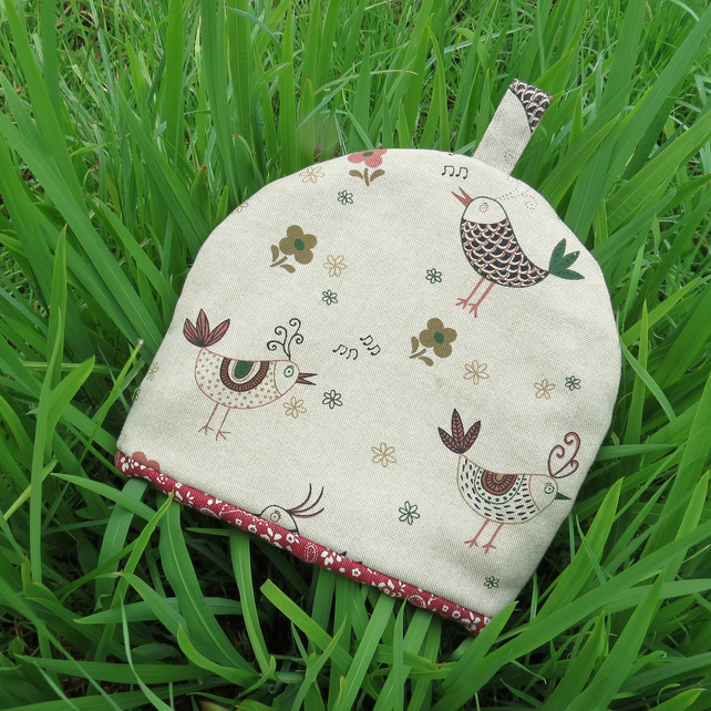 A tea cosy, size small.  To fit a 1- 2 cup teapot.  Chickens design.