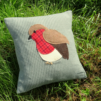 Robin cushion.  A festive robin made from tactile wool.  With feather pad.