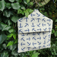 A peg bag with a nautical design.  Peg storage.